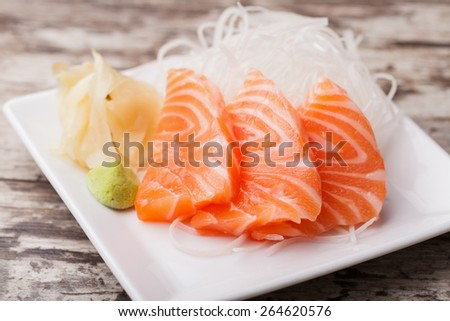 Salmon sashimi with withe plate - stock photo