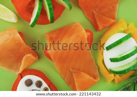 salmon slice and cooked egg and vegetables - stock photo