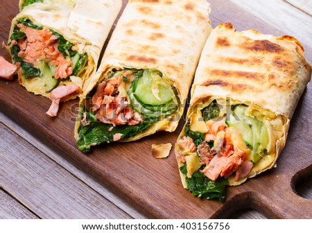 Salmon, Spinach, Cheese and Onion Burritos.