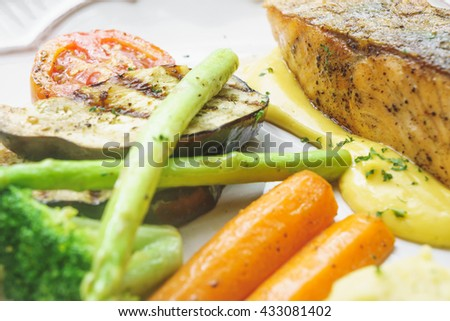 Salmon steak and roasted vegetables with lemon cream sauces