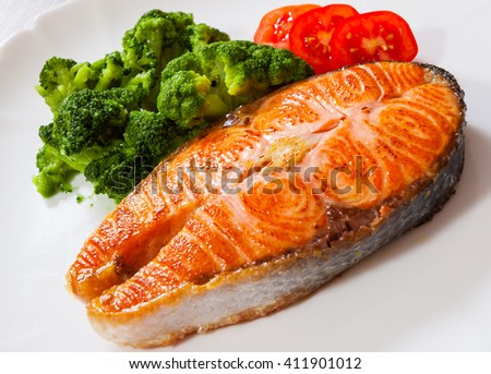Salmon steak fillet with broccoli - stock photo