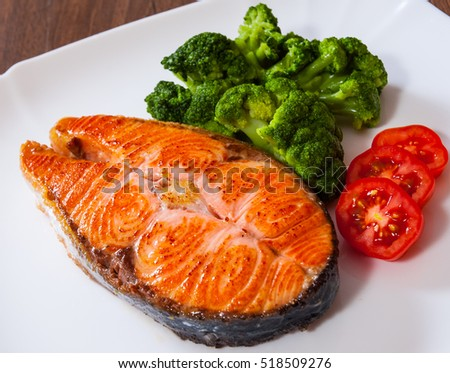 Salmon steak fish fillet with broccoli on plate