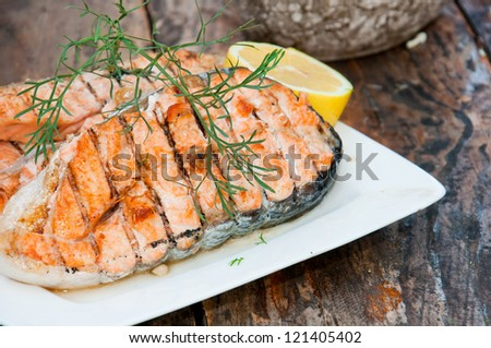 Salmon steak grilled with lemon - stock photo