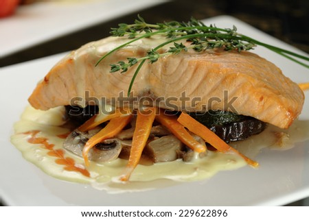 Salmon steak  on vegetable and mushroom  bed/ Mediterranean cuisine - stock photo