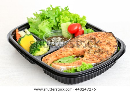 Salmon steak, the one of clean food menu served with fresh vegetables such as tomato, broccoli, pumpkin.  - stock photo