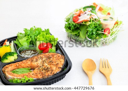 Salmon steak, the one of clen food menu served with fresh vegtables such as tometo, broccoli, pumpkin. - stock photo