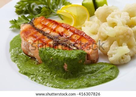 salmon steak with cauliflower - stock photo