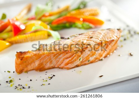 Salmon Steak with Corn and Green Asparagus - stock photo