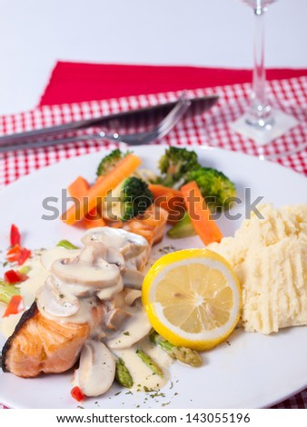 salmon steak with mushroom source - stock photo
