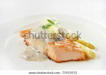 salmon steak with white asparagus - stock photo