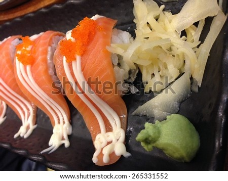salmon sushi on black plate - stock photo