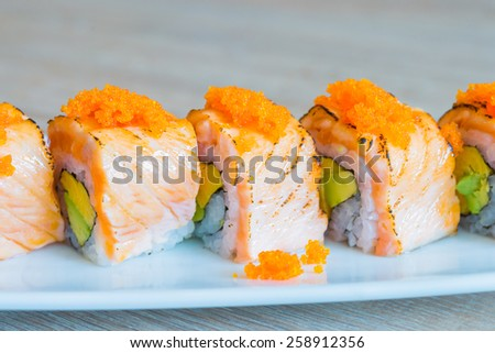 Salmon sushi roll japanese food style - selective focus point