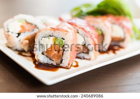 Salmon sushi roll maki - japanese food - stock photo