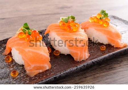 Salmon sushi with caviar - stock photo