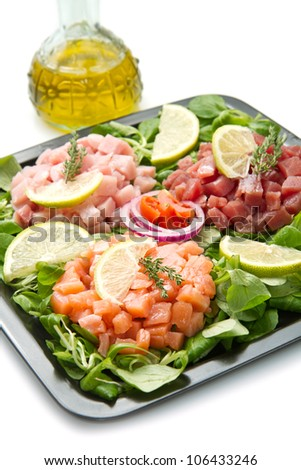salmon, tuna and swordfish tartar with fresh salad