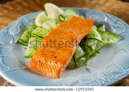 Salmon with cucumber salad - stock photo