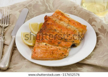 salmon with lemon on the white plate