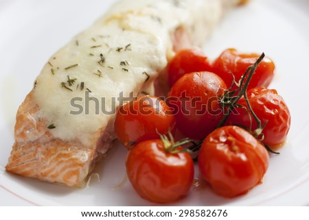 Salmon with mozzarella and baked cherry tomatoes. - stock photo