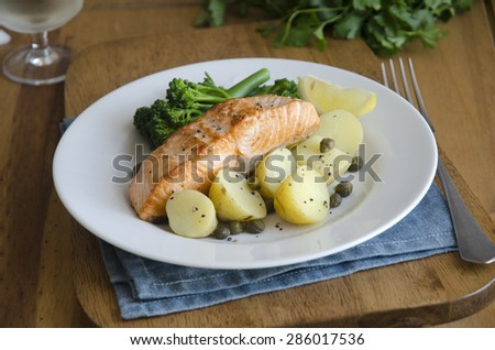 Salmon with mustard and caper potatoes - stock photo