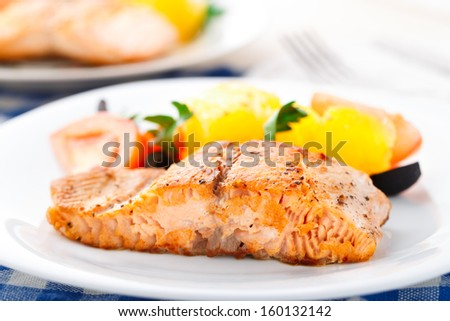 Salmon with oranges, tomatoes and olives - stock photo