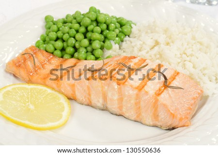 salmon with rosemary and vegetables - stock photo