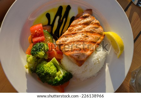 salmon with vegetables in Vancouver, Canada - stock photo