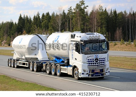 SALO, FINLAND - APRIL 29, 2016: White Mercedes-Benz Arocs 3258L tank truck of Kuljetus Auvinen hauls cement on motorway. Kuljetus Auvinen is a leading builder of super show trucks.  - stock photo
