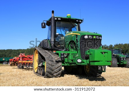 SALO, FINLAND - AUGUST 22, 2015: John Deere 8345RT tracked tractor and Vaderstad cultivator on display at Puontin Peltopaivat Agricultural Harvesting and Cultivating Show. - stock photo