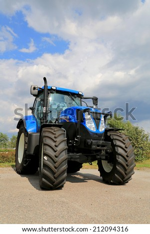 SALO, FINLAND - AUGUST 9, 2014: New Holland agricultural tractor T7.185 on display. New Holland Celebrates 50 Years of Tractors at Basildon.