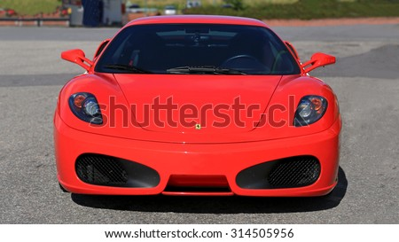 SALO, FINLAND - AUGUST 29, 2015: Red Ferrari F430 parked in Salo. The F430 is a sports car that was manufactured by the Italian manufacturer Ferrari from 2004 to 2009. - stock photo