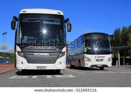 SALO, FINLAND - AUGUST 29, 2015: White Scania Touring and VDL Futura coach bus on the bus stop in Salo. The Scania Touring is a tourist coach with Chinese-build Higer bodywork. - stock photo
