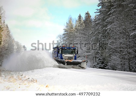 SALO, FINLAND - FEBRUARY 5, 2016: Scania truck equipped with snowplow clears a scenic highway in South of Finland. Destia takes care of the winter maintenance of the Finnish roads.