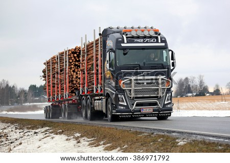 SALO, FINLAND -  FEBRUARY 19, 2016: Volvo FH16 750 logging truck hauls pulp wood along highway. The bioproduct mill of Metsa Group, currently under construction, will increase the demand of pulp wood. - stock photo