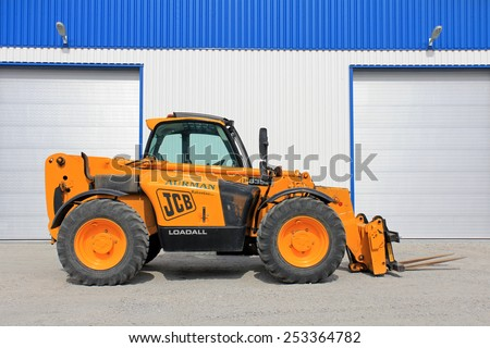 SALO, FINLAND - JULY 14, 2013: JCB 535-95 Telescopic handler by warehouse. The JCB 535-95 is a full-sized 3-stage telescopic handler with a max lift height of 9.5 m and max lift capacity of 3500 kg. - stock photo