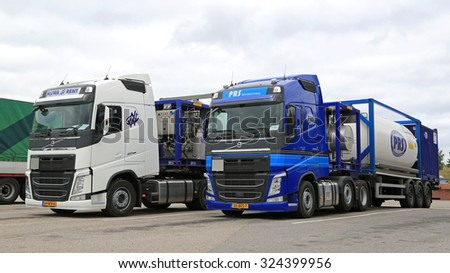 SALO, FINLAND - OCTOBER 4, 2015: Two Volvo FH Semi tank trucks for chemical transport. The two trucks transport goods from The Netherlands to Finland.  - stock photo