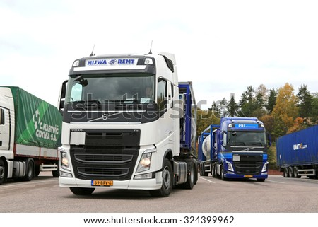 SALO, FINLAND - OCTOBER 4, 2015: Two Volvo FH tank trucks leave Salo truck stop. Volvo Trucks launches positioning service for time-critical transports. - stock photo