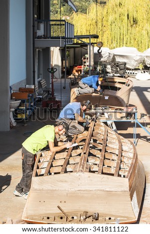 SALO, ITALY - OCT 26: Artisans at work in a shipyard in the construction of boats for the lake of Garda ON October 26, 2015 in Salo, Brescia province, Italy