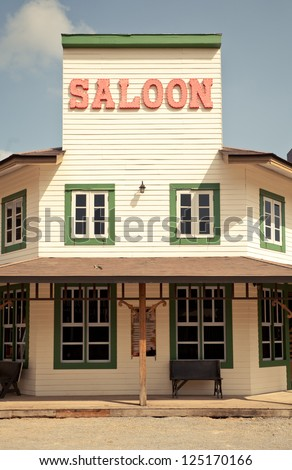 Saloon in Wild West style with blue sky - stock photo