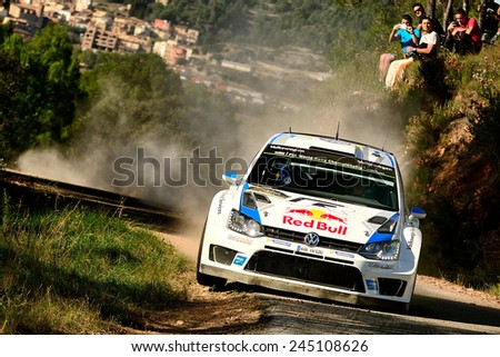 SALOU, SAPIN - OCT 25: French driver Sebastien Ogier and his codriver Julien Ingrassia in a Volkswagen Polo R WRC race in the 50th Rally RACC Rally of Spain, on Oct 25, 2014 in Salou, Spain. - stock photo