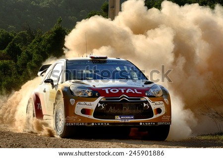 SALOU, SAPIN - OCT 25: Norwegian driver Mads Ostberg and his codriver Jonas Andersson in a Citroen DS3 WRC race in the 50th Rally RACC Rally of Spain, on Oct 25, 2014 in Salou, Spain. - stock photo