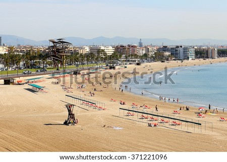 SALOU, SPAIN - MAY 25: The tourists enjoiying their vacation on the beach on May 25, 2015 in Salou, Spain. Up to 60 mln tourists is expected to visit Spain in year 2015. - stock photo