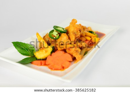salsa with mango, coriander and curry paste - stock photo