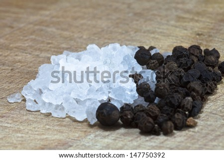 Salt a?? black paper on the wood table - stock photo