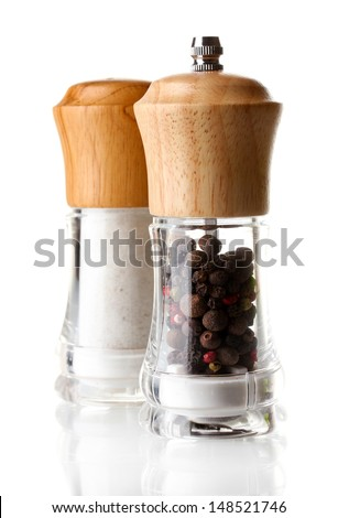 Salt and pepper mills isolated on white - stock photo
