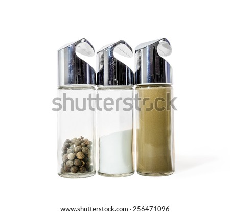Salt and pepper set-tableware for storage of spices on the table isolated on white background - stock photo