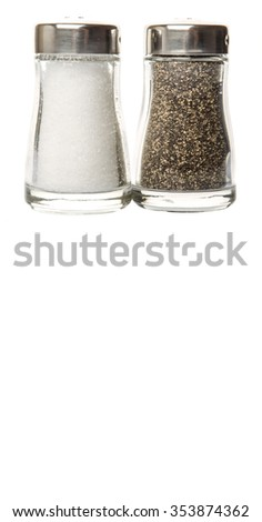 Salt and peppercorn powder in glass condiment shaker over white background - stock photo