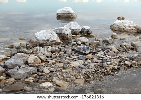 Salt at stones in Dead Sea , Israel - stock photo