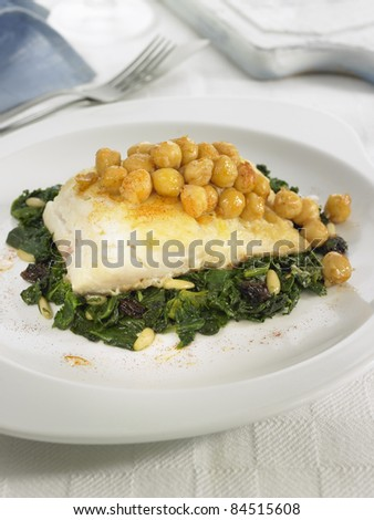 Salt-cod with chickpeas, spinach and pine nuts - stock photo