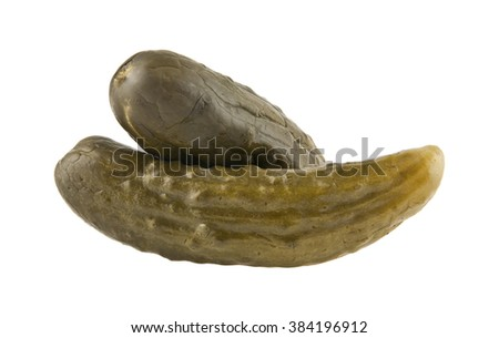 salt cucumber is isolated on a white background - stock photo