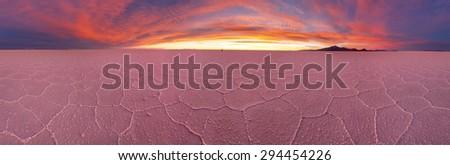 Salt desert Uyuni panorama at sunset, Bolivia - stock photo